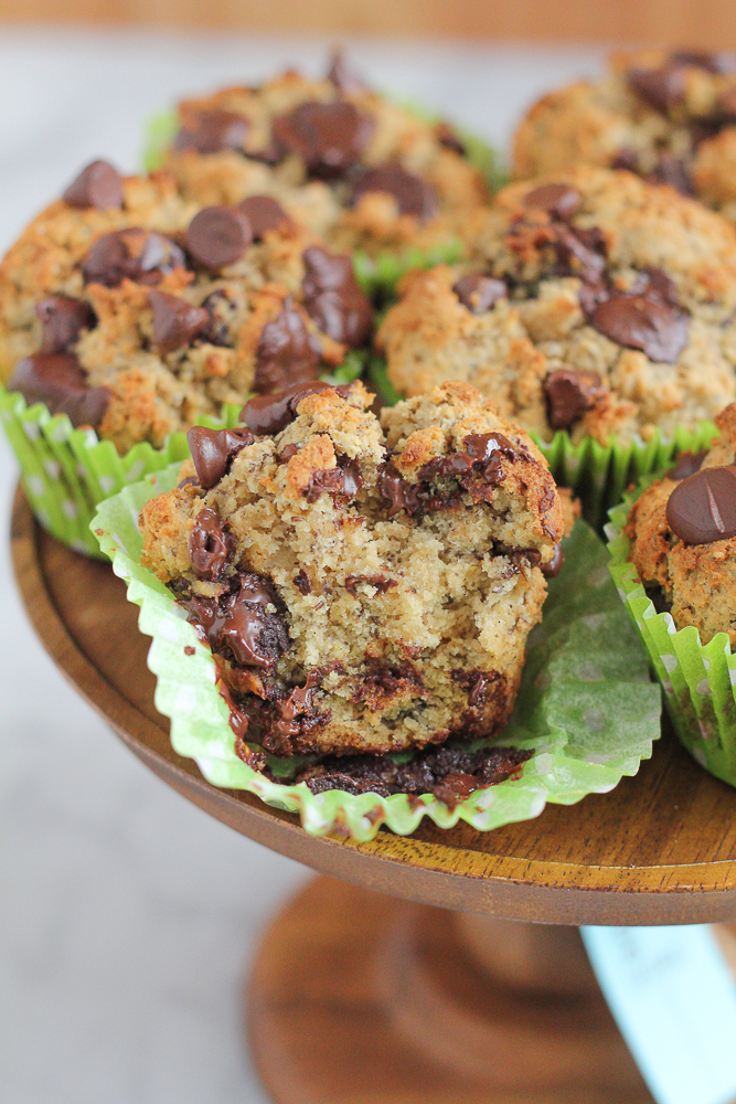 Healthy Wheat Almond Coconut Flaxseed Muffins! Made with a wheat and almond flour, coconut flour and ground flaxseed, these muffins have taste, texture and are filled with goodness! You don't have to feel guilty about indulging in one of these muffins!