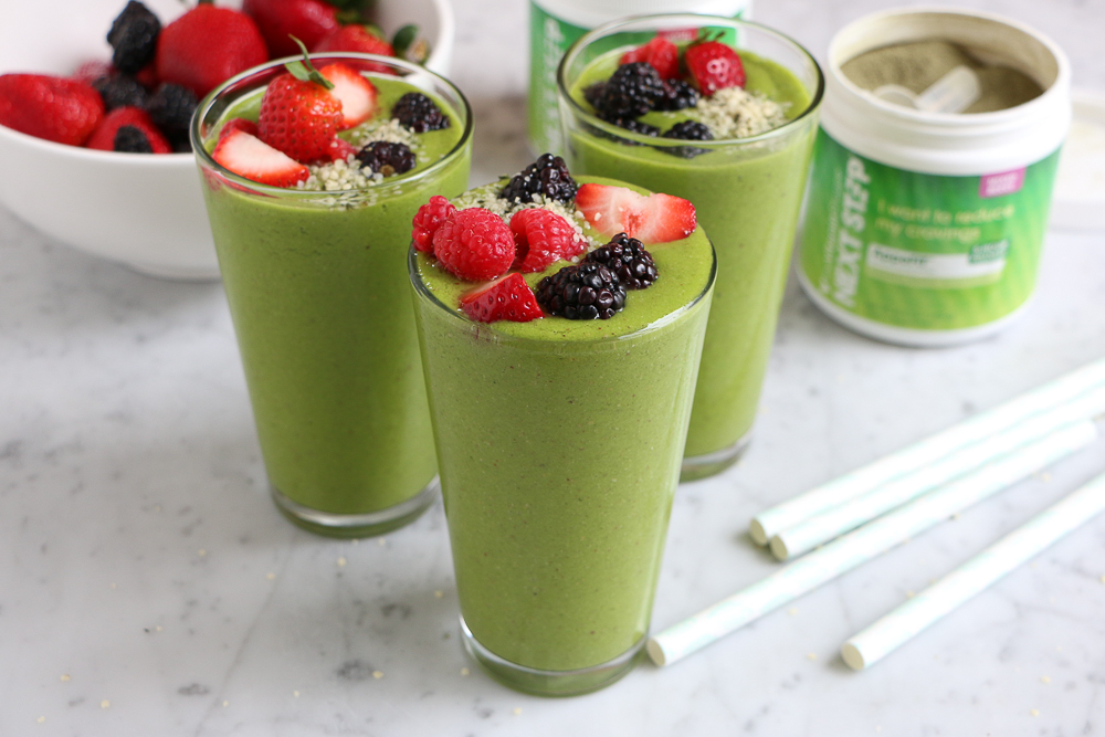 Spinach Berry Smoothie!! A refreshing spinach smoothie with bananas, mangos, almond butter and Next Step AppeFIT Mixed Berry Powder! You've got to try this!