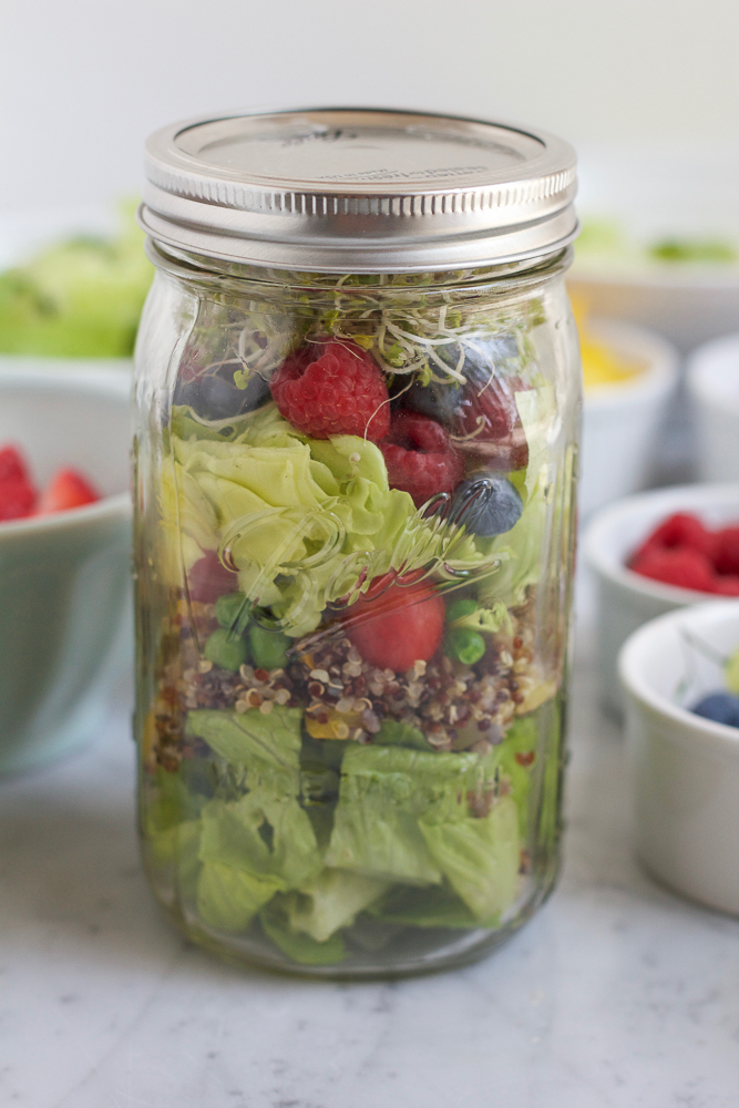 Mason Jar Salad! The perfect, portable way to eat healthy! Pack your mason jar salad with your favorite salad ingredients. Everything stays fresh until you need it! Just dump, mix, add your dressing and enjoy!