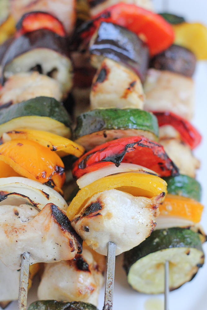 Grilled Chicken Kebabs!! Made with Just BARE Organic Chicken breast fillets, these Grilled Chicken Kebabs are delicious and flavorful. Marinate the cubed chicken overnight, assemble your kebabs and throw them on the grill! The perfect summer meal!
