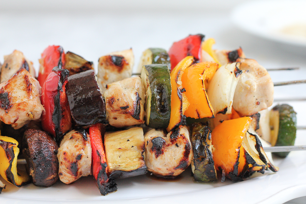 Grilled Chicken Kebabs on a white platter.