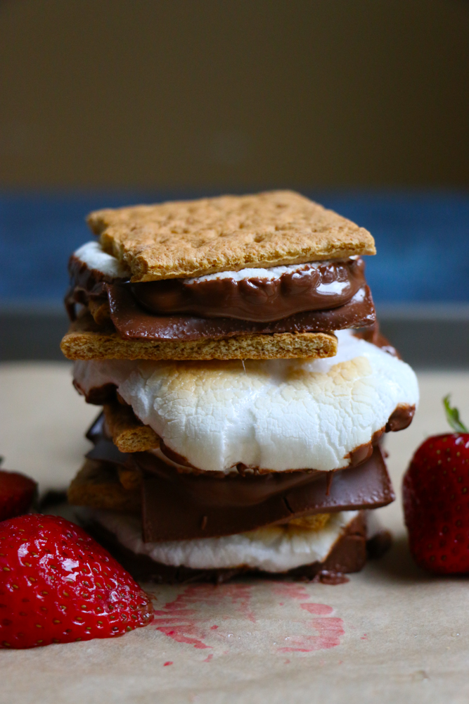Easy S'mores At Home! All made in your oven! Completely indulgent and yummy, this is the perfect quick, summer treat to make at home and share with friends and family!