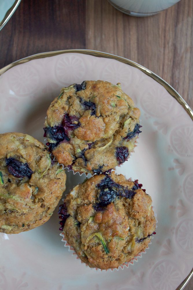 Blueberry Zucchini Muffins! Paired with milk, these muffins are a nutritious way to start the day and fuel your family!