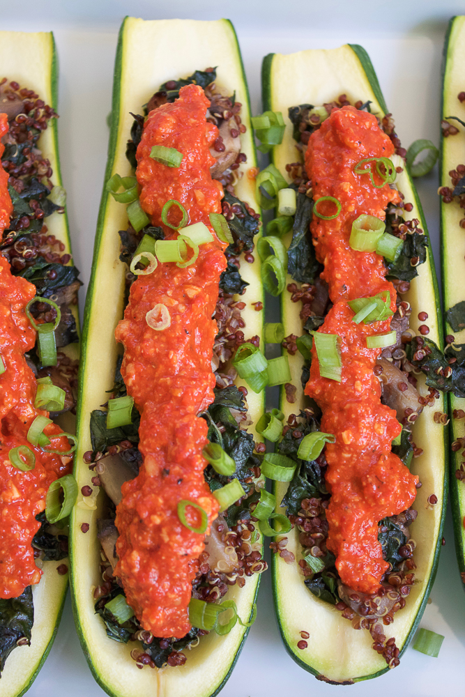Quinoa Stuffed Zucchini Boats! Serve these as a side dish or appetizer at your Labor Day cookout. Try this recipe plus other lighter options for a healthier Labor Day BBQ!!