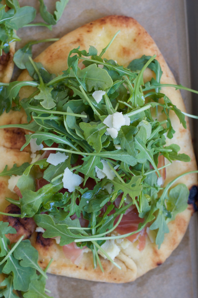 Prosciutto Arugula Flatbread Pizza! So easy to make and delicious! Perfect as an appetizer or main dish. Pick up everything you need from your local ALDI!