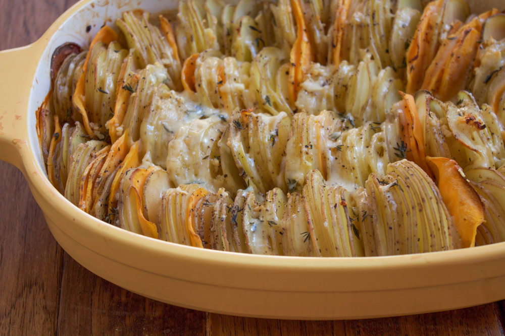 Hasselback Potato Gratin. Slices of Yukon gold potatoes and yams, topped with a delicious and light cheesy cream sauce. You have to try this!