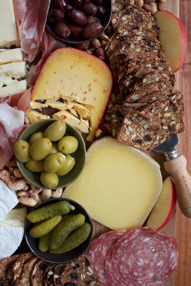 How To Make A Charcuterie Board + A Video! I'm sharing tips on how to assemble the best charcuterie board! Packed with meats, cheese, pickles, nuts, crackers and more, this is the easiest and most delicious platter to put together for your guests for the holidays! There's sure to be something there for everyone!