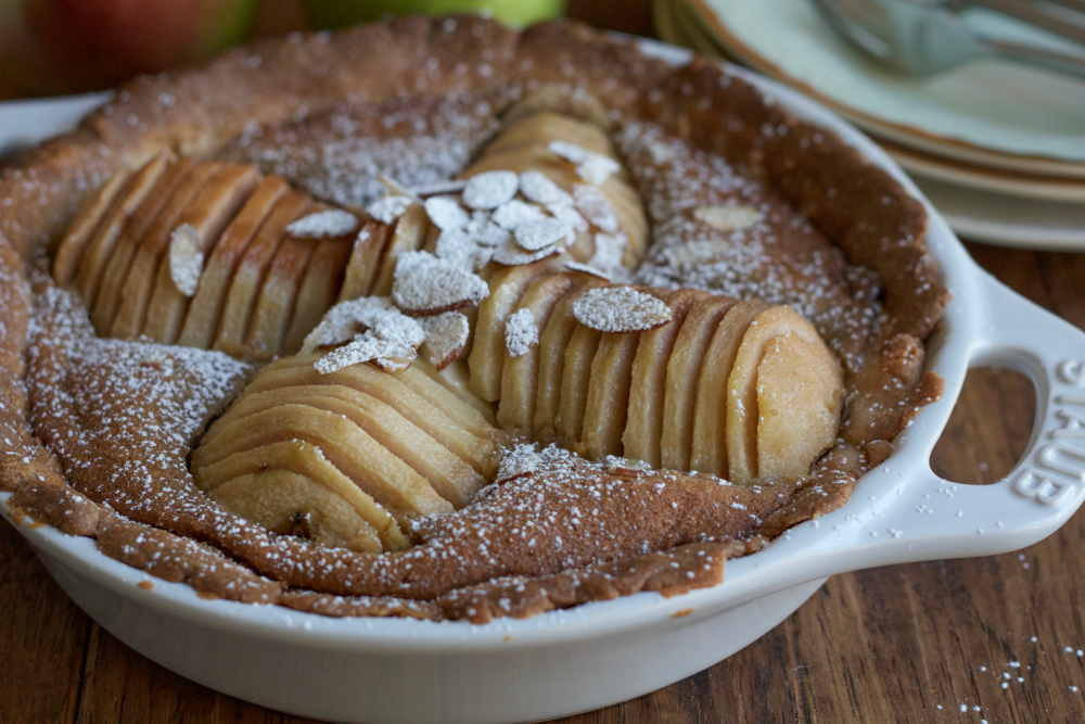 Pear Almond Tart made with poached pears, a tender, flavorful all-butter crust and a delicious almond filling. Not too sweet and amazing flavor! This is the most delicious tart ever!