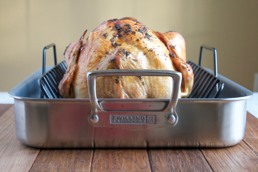Butter Roasted Turkey! Delicious, juicy and the most fabulous buttery, crispy skin ever! This turkey is brined, stuffed with aromatics and rubbed with a delicious herb butter rub. You have to try this!
