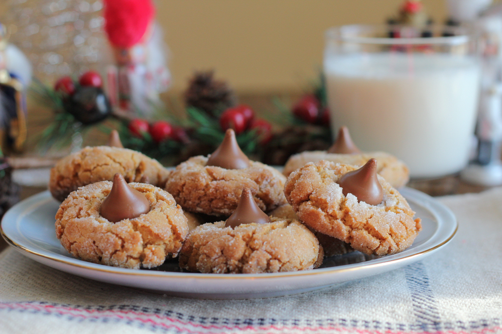 Holiday Peanut Butter Blossoms! Traditional, peanut buttery blossom crinkle cookies dressed up for the holidays! Drizzle on white or dark chocolate and decorate with festive, holiday sprinkles for fun!