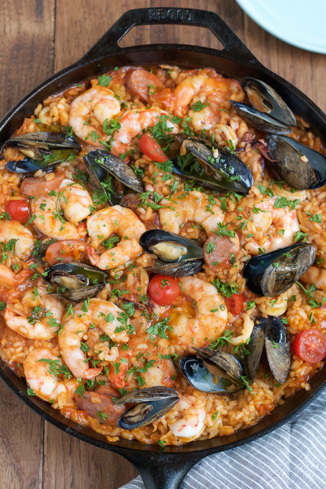Healthy Weekly Meal Plan 12.3.16! A healthy weekly meal plan featuring Seafood Paella, a Kale Bacon Manchego Pizza, Sweet Potato Black Bean Corn Enchiladas and more!