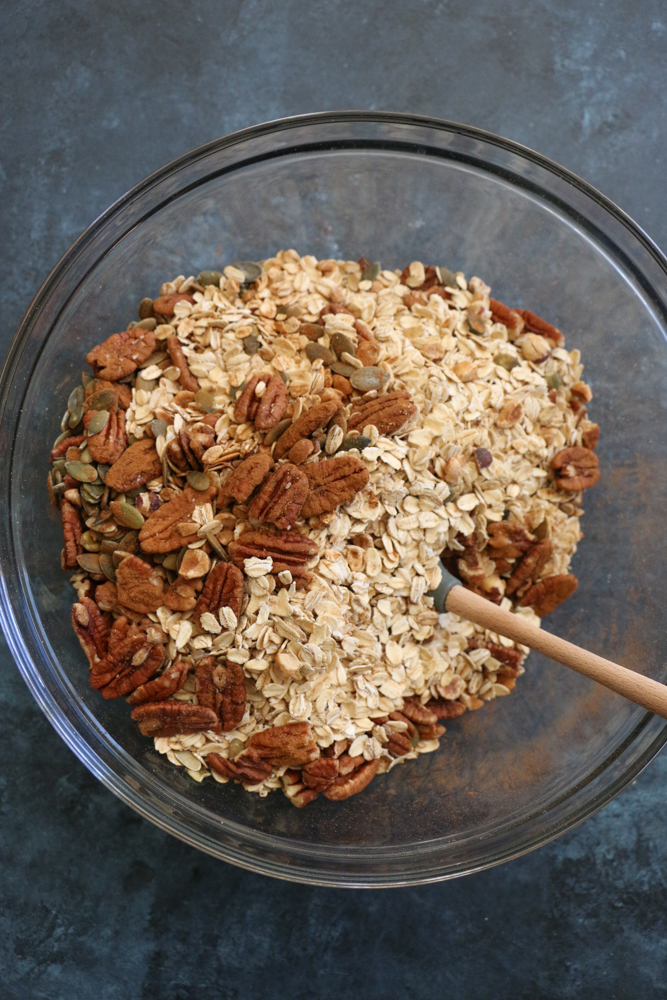 Gluten Free Granola!! Made with gluten free rolled oats, pecans, pepitas, dried fruit, coconut oil and naturally sweetened with some honey and maple syrup. You just can't beat freshly baked homemade granola! You've got to try this!