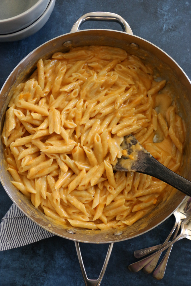 Creamy Stovetop Macaroni and Cheese made with fontina, cheddar and gruyere cheese. So delicious and so easy to make! Perfect for a weeknight dinner!