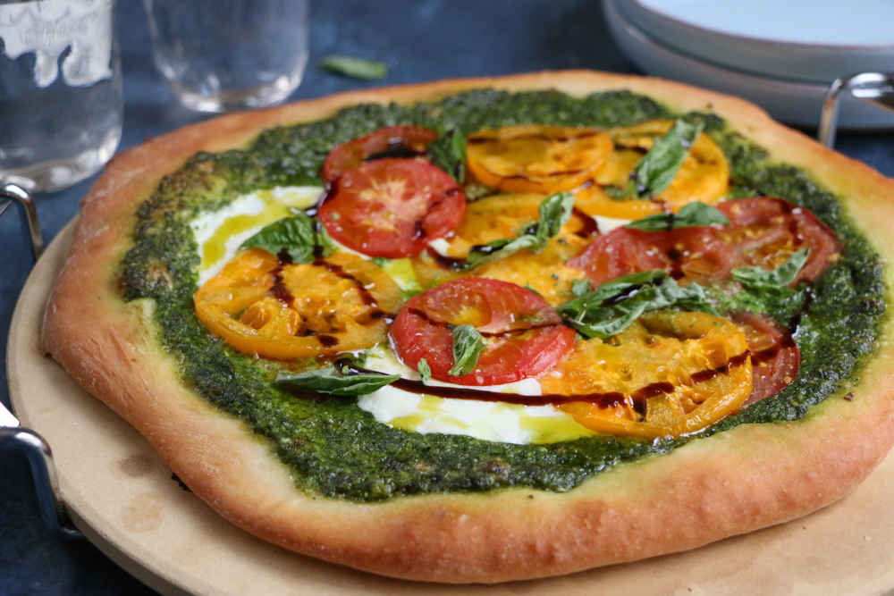 Delicious Caprese Pesto Pizza with a homemade pizza crust made with White Lily Flour! So good and so easy to make!