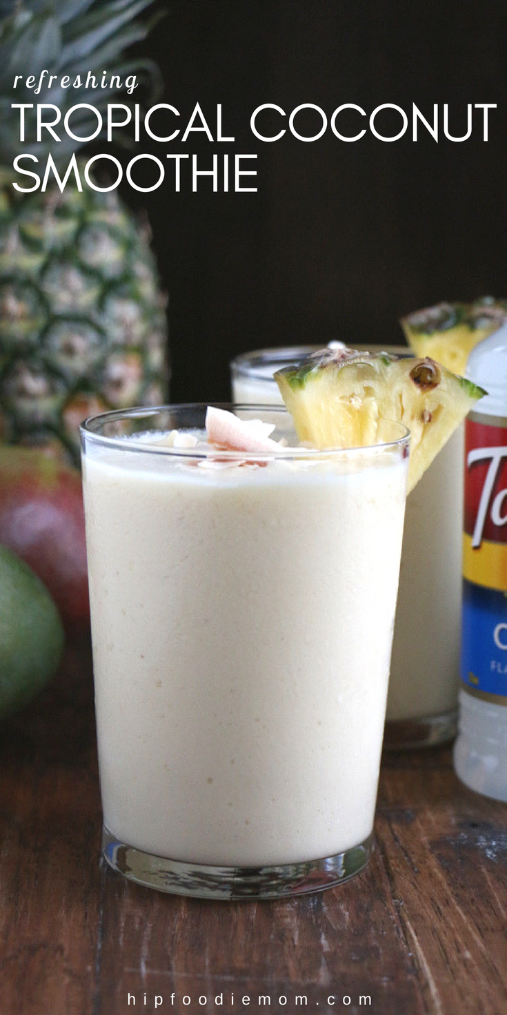 Refreshing Tropical Coconut Smoothie made with Torani Coconut Syrup,frozen mangos, pineapples and more! Let this smoothie transport you! #tropicalsmoothie #coconutsmoothie #smoothierecipe #mangosmoothie #pineapplesmoothie #breakfastsmoothie #coconut