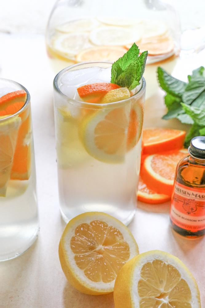 Orange Blossom Lemonade made with freshly squeezed lemon juice, simple syrup and Nielsen-Massey's Orange Blossom Water. So delicious and SO refreshing!