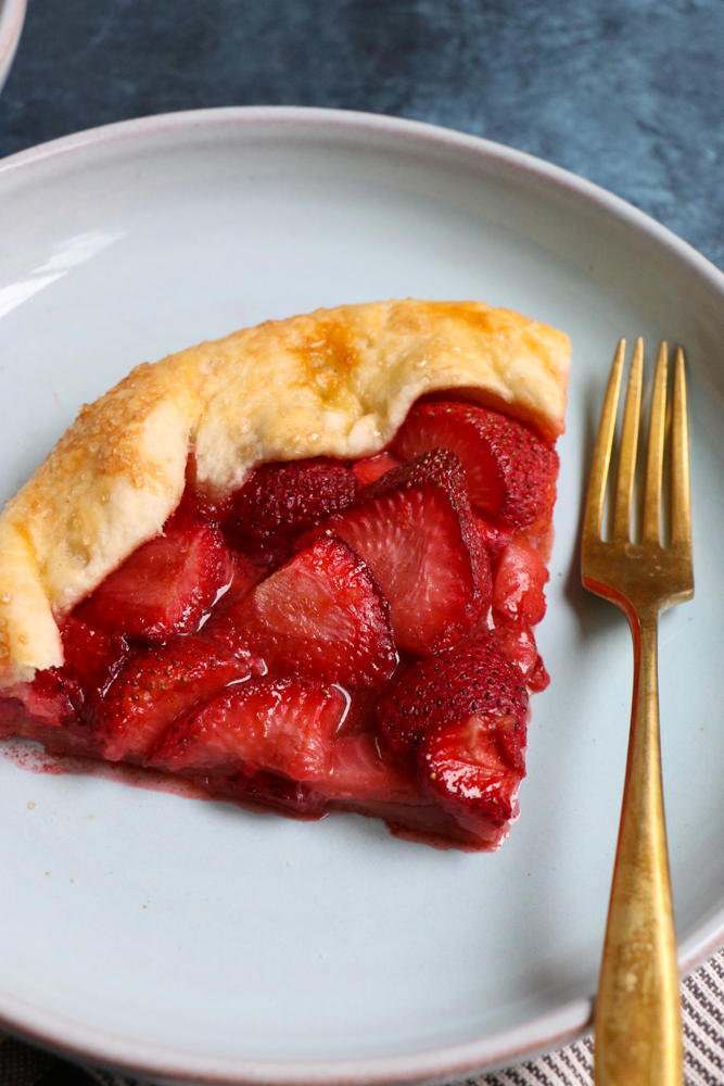 A piece of Strawberry Galette on a plate.