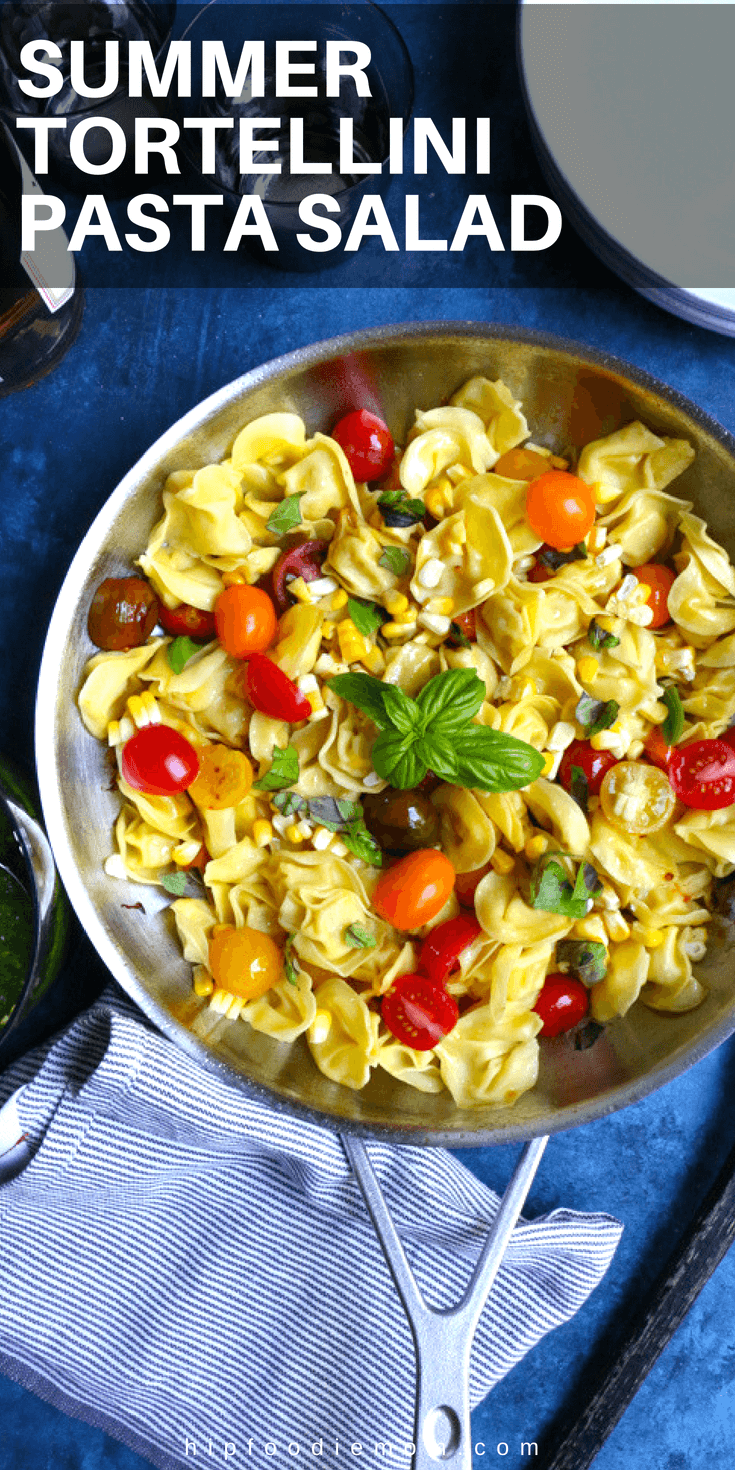 Summer Tortellini Pasta Salad! Pan fried five cheese tortellini cooked with cherry tomatoes, corn and a spinach pesto! So good! #tortellinisalad #pastasalad #pasta #summerpotluckrecipe #potluck #picnic #barbecue #bbqrecipe #bbq #tortellini