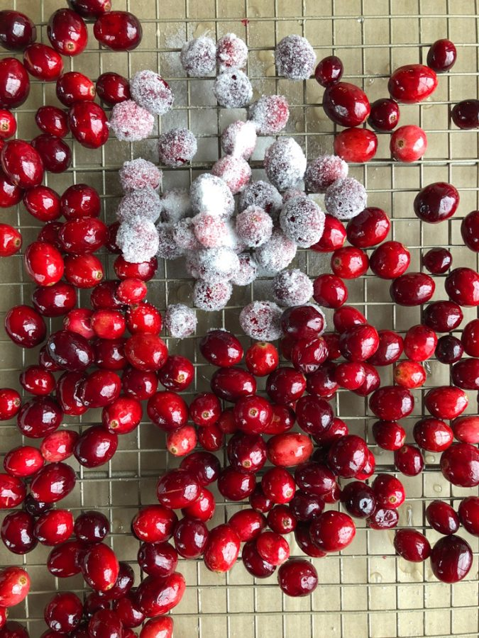 Sugared cranberries! The easiest, most festive way to decorate a holiday dessert, cocktail, or just to munch on!