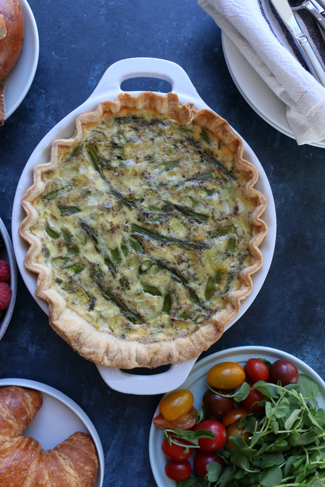 A delicious and flavorful asparagus and leek quiche made with an all butter pie dough! This is the perfect brunch to make for mom on Mother's Day!