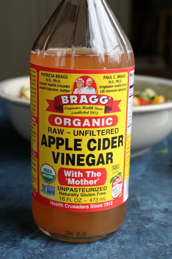 Bottle of apple cider vinegar for Super Simple Cucumber Tomato Salad.