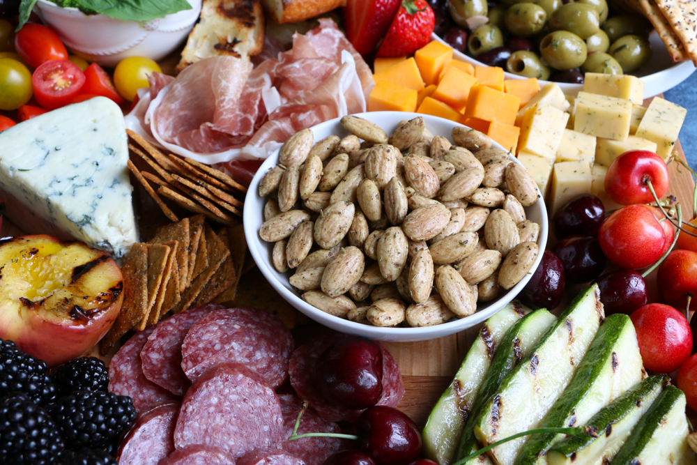 My Summer Cheese and Charcuterie Board with Blue Diamond Crafted Gourmet Garlic Herb and Olive Oil almonds! Summer entertaining is not complete without a cheese and charcuterie board like this!