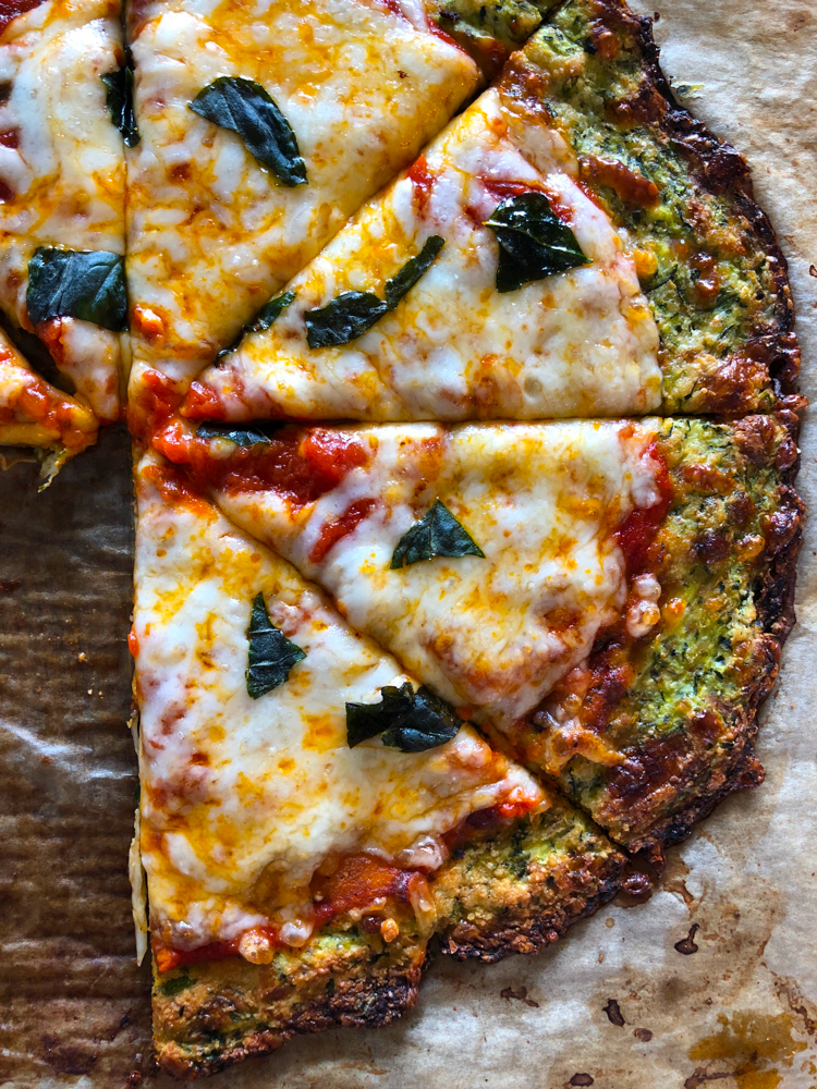 Zucchini Pizza Crust! Low carb and so delicious! You won't believe this is a Zucchini Pizza Crust! Read the entire recipe to see my secret ingredient!
