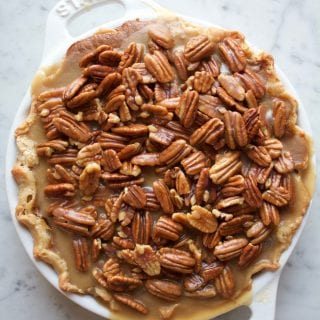 Pecan Apple Pumpkin Pie! The ultimate Thanksgiving pie with a layer of spiced apples, pumpkin pie filling and caramelized pecans on top!