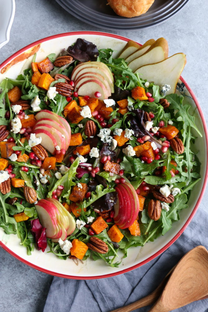 Autumn Salad with Seasoned Roasted Butternut Squash! Fresh mixed greens and arugula, apples, pears, toasted pecans and the seasoned roasted butternut squash, this is fall in a salad! You need this salad on your Thanksgiving Day table!