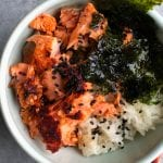 Asian Salmon Rice Bowl! Seasoned lemon pepper baked salmon served over rice with a hint of sesame oil and served with nori.