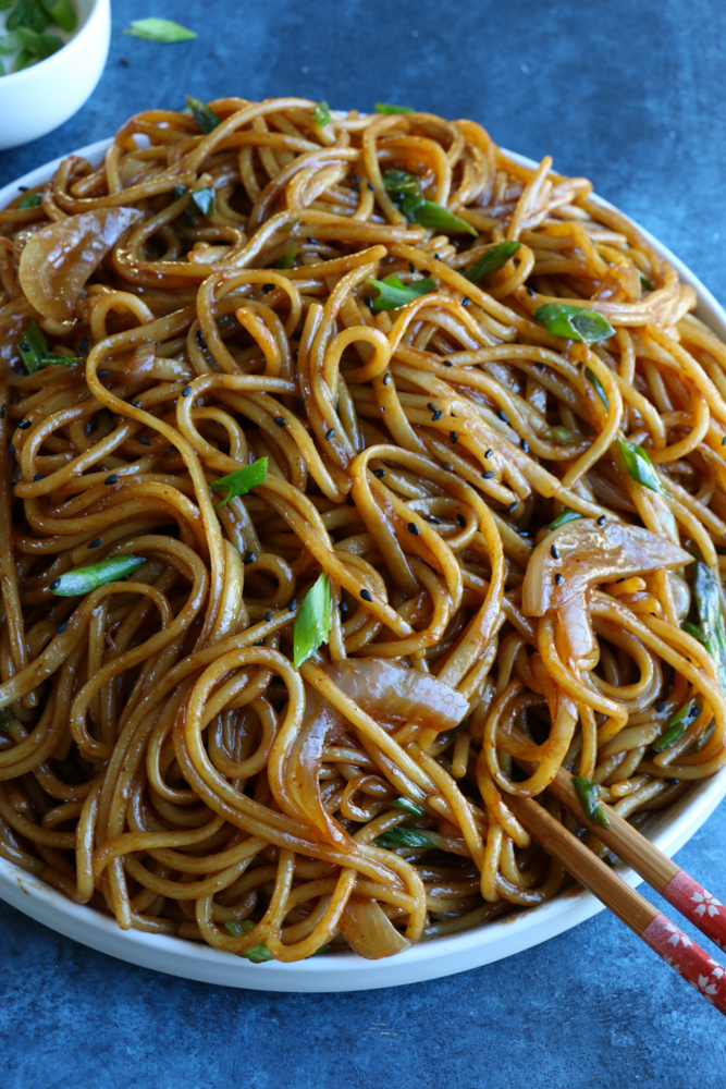 Super Simple Veggie Lo Mein! This is a bare bones version, using only an onion and some scallions. Perfect for a meatless meal, this recipe comes together in about 25 minutes! Enjoy!
