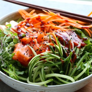 Sashimi Salad Bowl! Sliced sashimi over a bed of lettuce with fresh cucumbers, carrots, thinly sliced apples and a spicy gochujang sauce!
