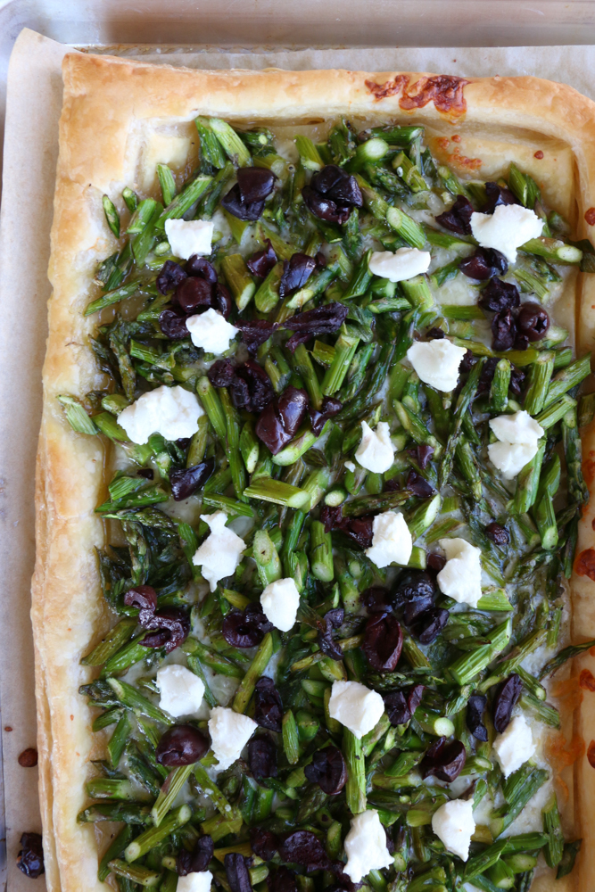 Asparagus Goat Cheese Tart! From America's Test Kitchen and Cook's Illustrated new cookbook, Vegetables Illustrated! Light, flaky and buttery and so much flavor from the asparagus, olives and goat cheese! You're going to love this!