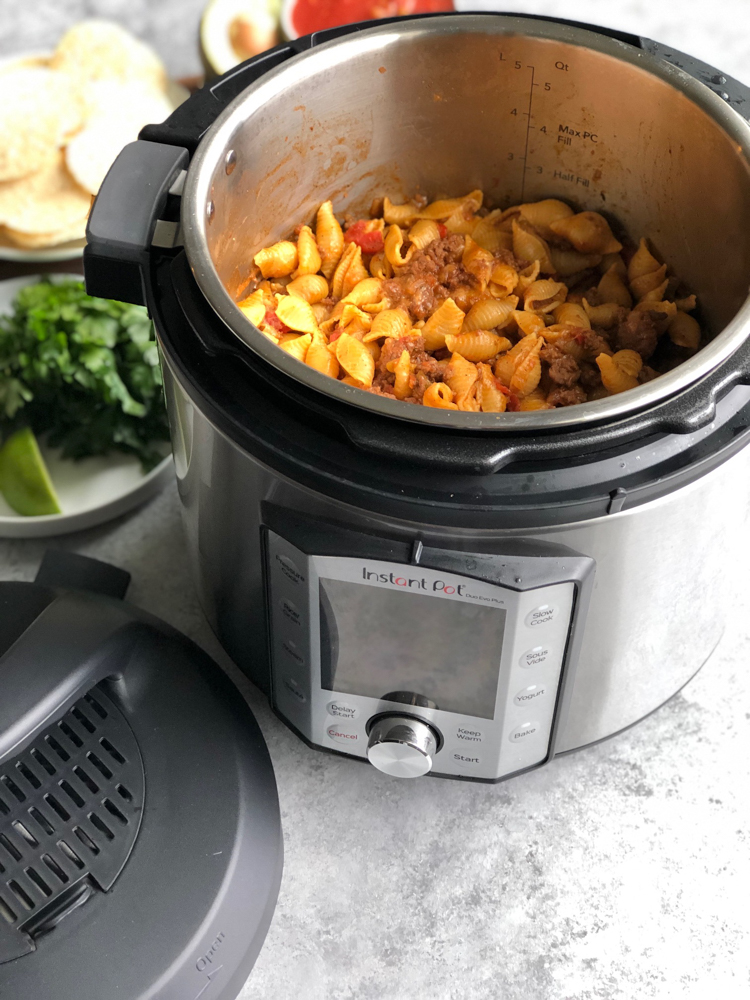 Instant Pot Cheesy Taco Pasta!! Creamy, so flavorful and delicious, easily made in the Instant Pot without pre-cooking the pasta!!